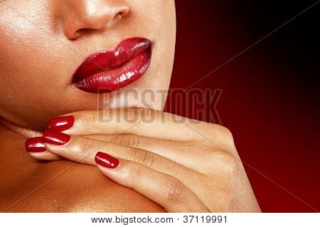 Young woman face detail closeup, mulatto fresh fashion girl with vivid red lips. Isolated