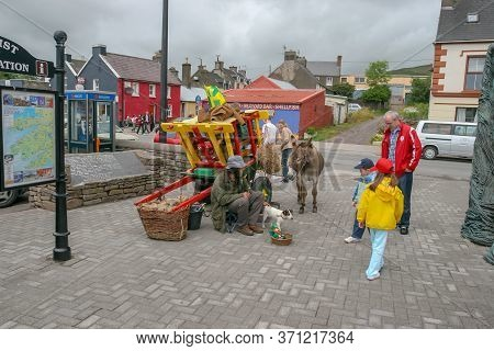 Dingle, Ireland - July 05,  2005: Main Street In Beautiful Village Of Dingle Situated On Dingle Peni