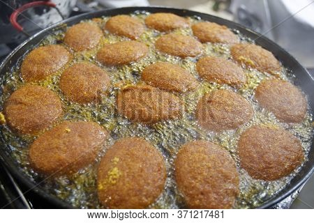 Salvador, Bahia / Brazil - May 9, 2016: Acaraje Fried In Palm Oil In The City Of Salvador. Typical D