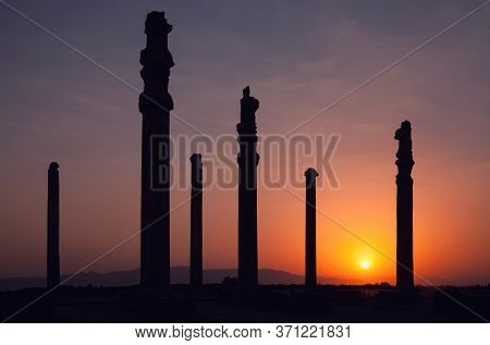 Silhouette Of Apadana Palace Ruins In Persepolis Archeological Site Of Shiraz Against Orange Sky And
