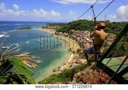 Cairu, Bahia / Brazil - Novembro 14, 2013: Tourist Enjoy The Look During The 70 Meter High Zip Line