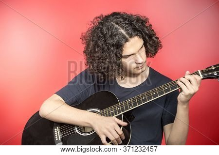 Teenager With Guitar, Young Musician Teenager With Guitar, Young Musician. Portrait Of Serious Teena