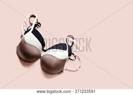Stack Of Sexy Bras On Pink Background, Bra. Push Up Lingerie, Classic Colors: White, Black, Beige