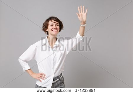 Pleasant Young Business Woman In White Shirt Posing Isolated On Grey Background In Studio. Achieveme