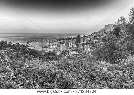 Panoramic View Of Monaco At Sunset From The Grande Corniche Road, Iconic Landmark In Cote D'azur, Fr