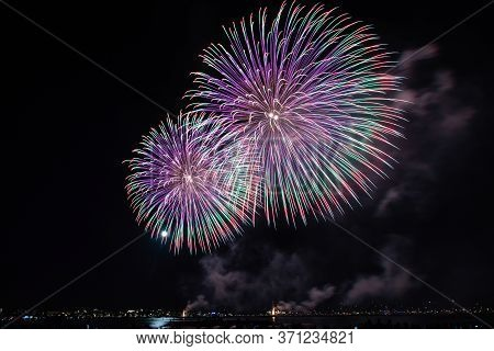 Scenic Fireworks Glowing In The Night For The 14th Of July Celebrations In The Harbor Of Cannes, Cot