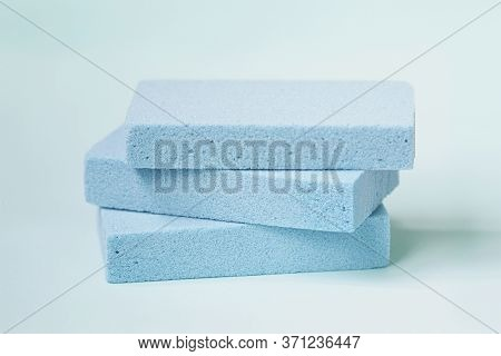 Blue Pumice Stone Foot Scrubbers On Blue Background