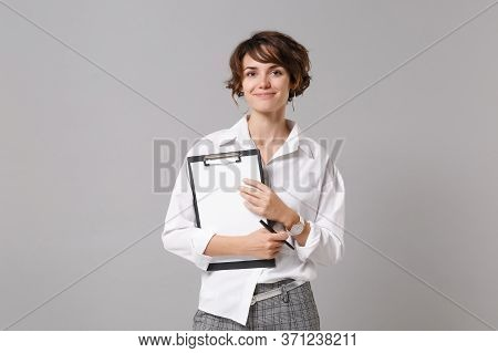 Smiling Young Business Woman In White Shirt Posing Isolated On Grey Wall Background. Achievement Car