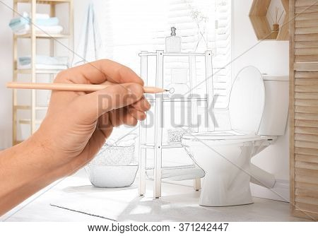 Man Drawing Bathroom Interior Design. Combination Of Photo And Sketch