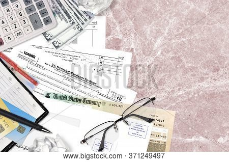 Irs Form 1040nr Nonresident Alien Income Tax Return Lies On Flat Lay Office Table And Ready To Fill.