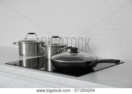New Cookware On Induction Stove In Kitchen