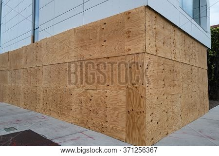 Exterior-grade C, At Minimum. Hurricane Plywood Installation. Boarding Up Windows With Plywood Preve