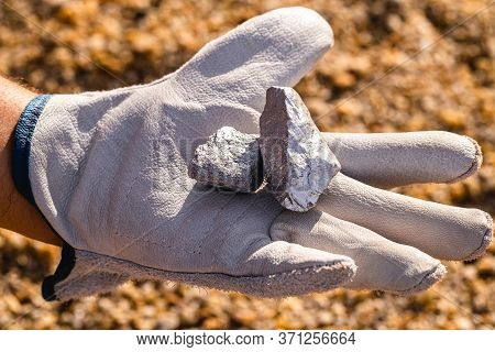 Hand Holding Silver Stones, Silver Ore. Gemstone Mining Concept