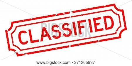 Grunge Red Classified Word Rubber Seal Stamp On White Background