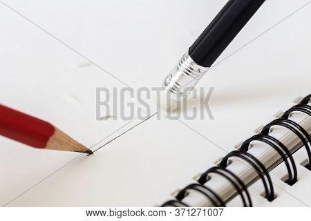 Close Up Of A Pencil Eraser On A Book