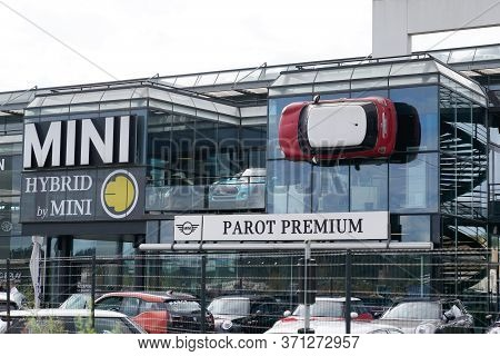 Bordeaux , Aquitaine / France - 10 17 2019 : Mini Red Car Is Fixed Into Building Wall At Bmw Mini Co