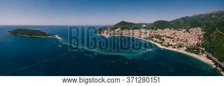 Panorama From The Drone. The Coast Of Budva In Montenegro And The Island Of St. Nicholas. The Isthmu