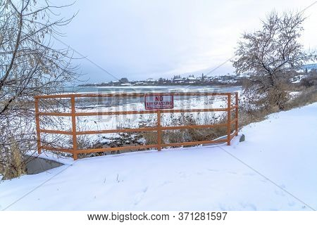 Scenic Utah Lake In Winter With No Trespassing Sign A Fence In The Foreground