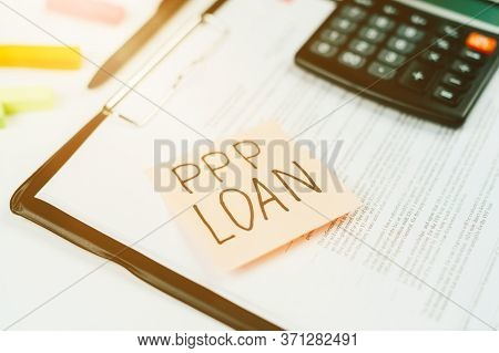 Sticker With The Text Ppp Loan On The Tablet For Papers, Forms For Filling Out A Loan Application.