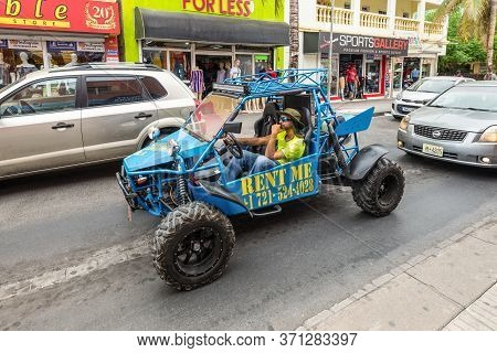 Philipsburg, St. Maarten - May 1, 2019: Unidentified Man In A Dune Buggy On The Streets Of The Phili