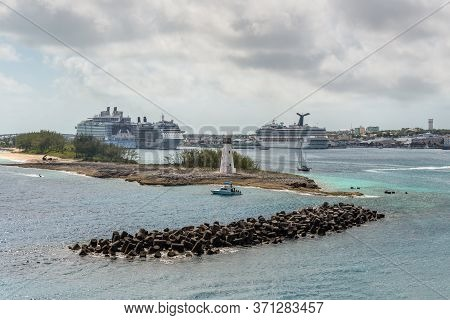 Nassau, Bahamas - May 3, 2019: View Of Lighthouse In Nassau, Bahamas And Cruise Ships In The Port In