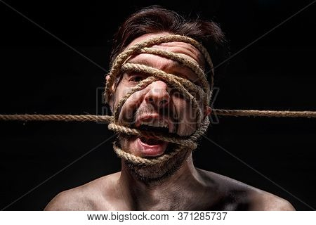 Image Of Binded Man With Rope On Face