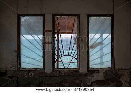 View Of The Sea Through The Windows Of An Abandoned House