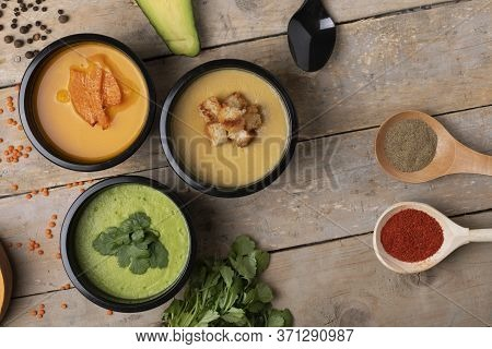Set Of Colored Soups In Food Boxes For Delivery. Broccoli Cream Soup And Pumpkin Soup. View Above