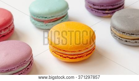 Tasty Macaroons On Table, White Background. Close-up. Top View. French Dessert Cake Macaron Or Macar