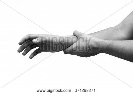 Man Suffering From Wrist Pain, Isolated, Black And White Photo. Causes Of Pain Include Sprains In Th