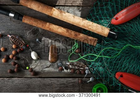 Fishing Tackle On Old Vintage Wooden Background With Copy Space. Flat Lay, Fishing Rods, Reel,  Bait