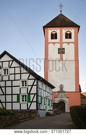 Center Of Village Odenthal With Parish Church And Old Buildings At Sunrise, Bergisches Land, Germany