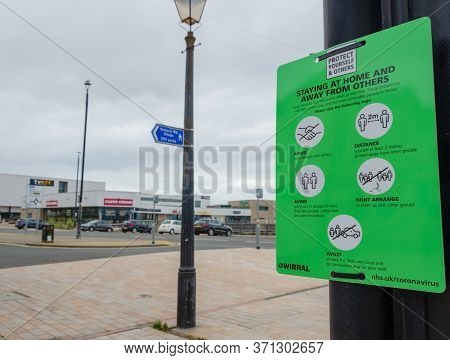 New Brighton, Uk: Jun 3, 2020: A Sign Gives Public Advice About Social Distancing And Avoiding The S