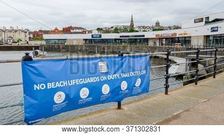 New Brighton, Uk: Jun 3, 2020: A Sign At Marine Lake Advises That There Are No Beach Lifeguards On D