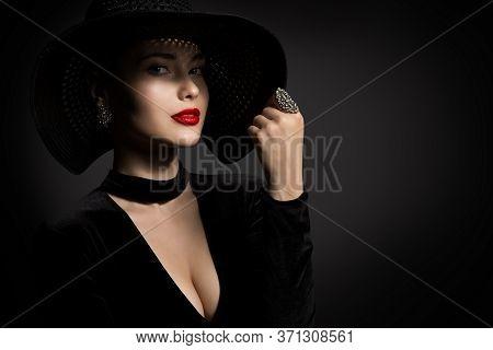 Beautiful Woman In Black Hat, Elegant Lady Beauty Studio Portrait In Black Dress