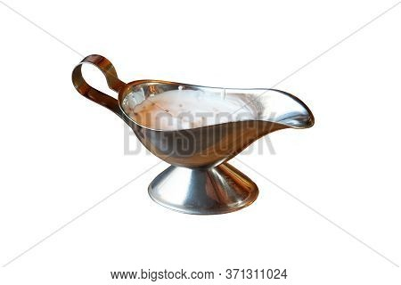 Metal Gravy Boat Isolated On A White Background. Stuffed Gravy Boat With Cream Sauce