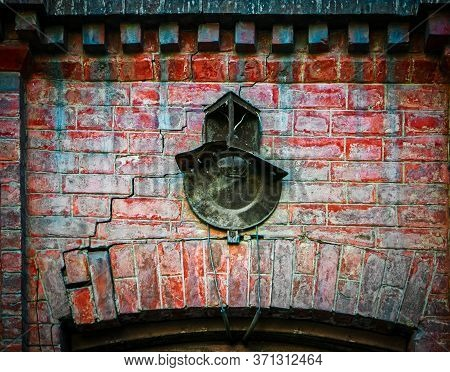 The Wall Of The Old Brick Building Is Covered With Cracks, It Fortified The Rusty Num Of The House,