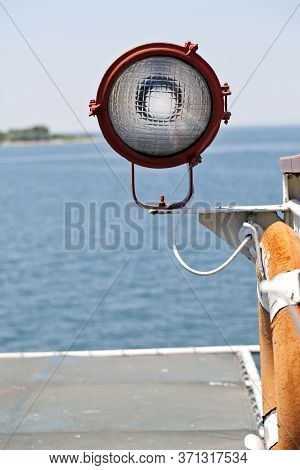 Strong Powerful Light Lamp In A Ferryboat And Ship Holes Photo