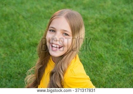 Facial Care. Kid Beauty And Fashion. Teen Girl After Hairdresser. Relax On Green Grass. Spring Leisu