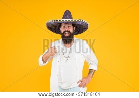 Ethnic Origins. Customs And Culture. Guy Cheerful Festive Mood At Party. Man In Mexican Hat. Explore