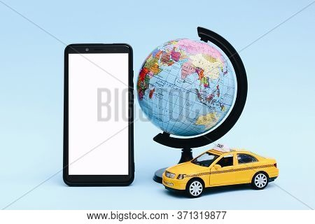 Urban Taxi And Delivery Service Concept. Toy Yellow Taxi Car Model On Blue Background. Copy Space Fo