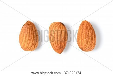 Three Peeled Almonds Isolated On White Background. Almonds Are Very Popular Nuts And High Protein. H