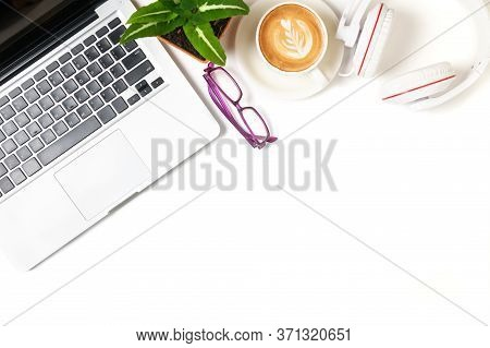 Laptop And Headphone With Latte Art Hot Coffee Isolated On White Background, Top View And Copy Space