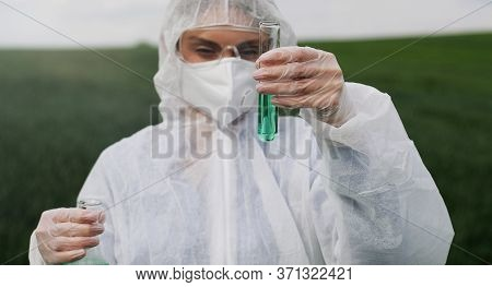 Close Up Of The Tet Tube With Chemical Liquid In Hands Of Female Caucasian Researcher Who Standing I