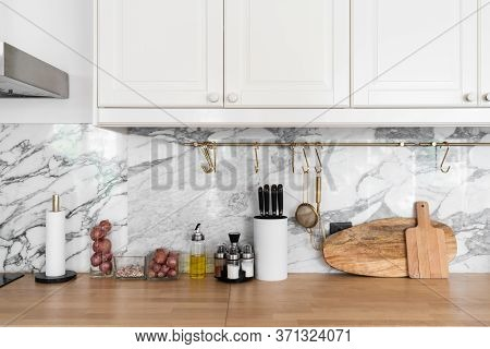 Modern Classic Kitchen Interior With Kitchen Appliances And Raw Ingredients On Wood Top With Marble
