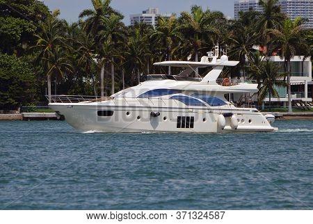 Medium Sized White Motor Yacht On The Florida Intra-coastal Waterway Near Miami Beach.