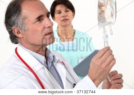 Doctor hooking up an IV