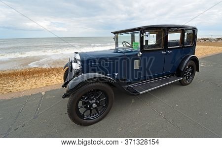 Felixstowe, Suffolk, England - May 05, 2019: Vintage Blue Motorcar Parked On Seafront Promenade With
