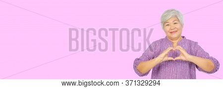 Love And Old People Concept - Happy Senior Woman Showing Hand Heart Gesture And Smiling, Take Care O