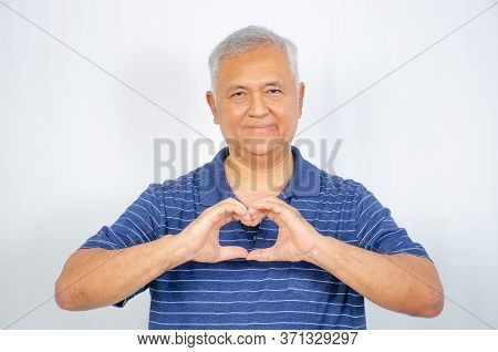 Love And Old People Concept -  Happy Senior Man Showing Hand Heart Gesture And Smiling, Take Care Of